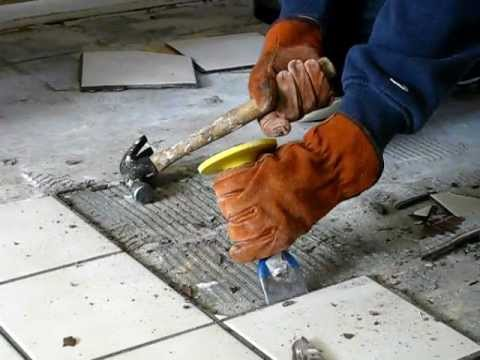 Image of person removing tile